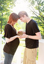 Pregnant couple with nest a expecting women and her husband holding a Royalty Free Stock Image