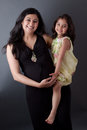 Pregnant East Indian Woman with her Daughter Royalty Free Stock Image