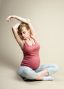 image photo : Pregnant female is engaged in yoga