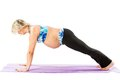 Pregnant fitness woman make stretch on yoga and pilates pose on white background the concept of sport health Royalty Free Stock Photo