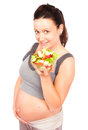 Pregnant food young woman with vegetables refers to healthy life Stock Images