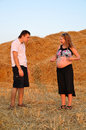 The pregnant girl and the guy on a mow Stock Photos