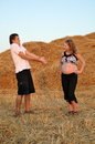 The pregnant girl and the guy on a mow guesses who will be born Stock Photography