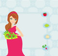 Pregnant girl with a plate of salad Stock Photo