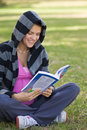 Pregnant Girl reading a book Royalty Free Stock Photo