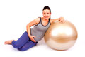 Pregnant gym beautiful woman relaxing wirh fitness ball isolated Royalty Free Stock Photos