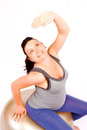 Pregnant gym young woman making exercise on fitness ball isolated Stock Images