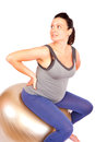 Pregnant gym young woman making exercise on fitness ball isolated Stock Photos