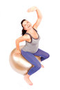 Pregnant gym young woman making exercise on fitness ball isolated Royalty Free Stock Photos
