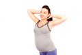 Pregnant gym young woman making isolated Stock Image