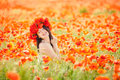 Pregnant happy woman in a flowering poppy field outdoors beautiful wreath summer outdoor portrait Royalty Free Stock Photography