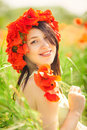Pregnant happy woman in a flowering poppy field outdoors beautiful wreath summer outdoor portrait Stock Photography