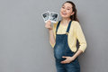 Pregnant happy woman holding ultrasound scans Royalty Free Stock Photo