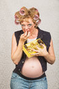 Pregnant lady pigging out hillbilly female indulging in box of candy Stock Photos