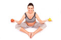 Pregnant meditation woman in yoga position with fruits refers to healthy lifestyle Stock Photos
