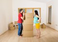 Pregnant mother and happy father in new house handsome are going to move to couple Royalty Free Stock Photo
