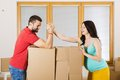 Pregnant mother and happy father in new house handsome are going to move to couple Royalty Free Stock Image