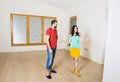 Pregnant mother and happy father in new house handsome are going to move to couple Stock Photography