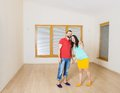 Pregnant mother and happy father in new house handsome are going to move to couple Royalty Free Stock Images