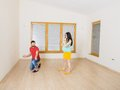 Pregnant mother and happy father in new house handsome are going to move to couple Stock Photos