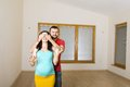 Pregnant mother and happy father in new house handsome are going to move to couple Stock Photo