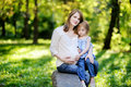 Pregnant mother with her small daughter Royalty Free Stock Images