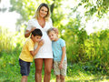 Pregnant mother with two sons Royalty Free Stock Image