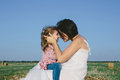 Pregnant mother in white dress hugging her daughter outdoor Royalty Free Stock Photo