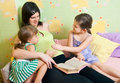 Pregnant mum with two daughters Royalty Free Stock Image