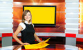 Pregnant television anchorwoman at TV studio Stock Photos