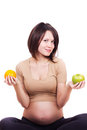 Pregnant woman with an apple and an orange Stock Photo