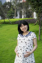 Pregnant woman asian in nature Royalty Free Stock Photo