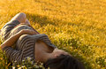 Pregnant woman beautiful lying on flowers Stock Image