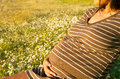 Pregnant woman beautiful relaxing outside in the park Royalty Free Stock Photos