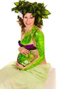 Pregnant woman with body-art with green leaves Stock Photos