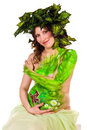 Pregnant woman with body-art with green leaves Royalty Free Stock Photography