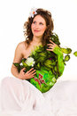 Pregnant woman with body-art with green leaves Royalty Free Stock Images