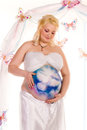 Pregnant woman with body-art with littlle dragon Stock Image