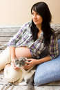 Pregnant woman with cat Stock Photography