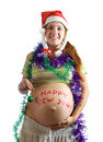 Pregnant woman in Christmas attire Royalty Free Stock Image