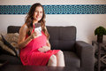 Pregnant woman craving chocolate cute young a bar of and smiling Stock Photos