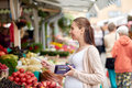 Pregnant woman with credit card at street market Royalty Free Stock Photo