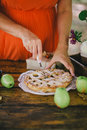 Pregnant woman cutting home-made apple pie Royalty Free Stock Photo