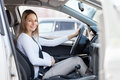 Pregnant woman driving her car Royalty Free Stock Photo