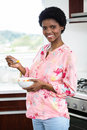 Pregnant woman eating fruit salad in kitchen Royalty Free Stock Photography