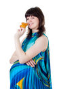 The pregnant woman eats a fruitcake Royalty Free Stock Images