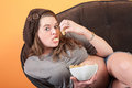 Pregnant Woman Eats Potato Wafers Stock Images