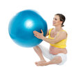 Pregnant woman excercises with a gymnastic ball Stock Image