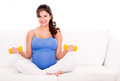Pregnant woman exercising Royalty Free Stock Photos