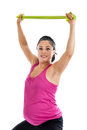 Pregnant woman exercising with resistance band beautiful hispanic arms isolated on white background Stock Photos